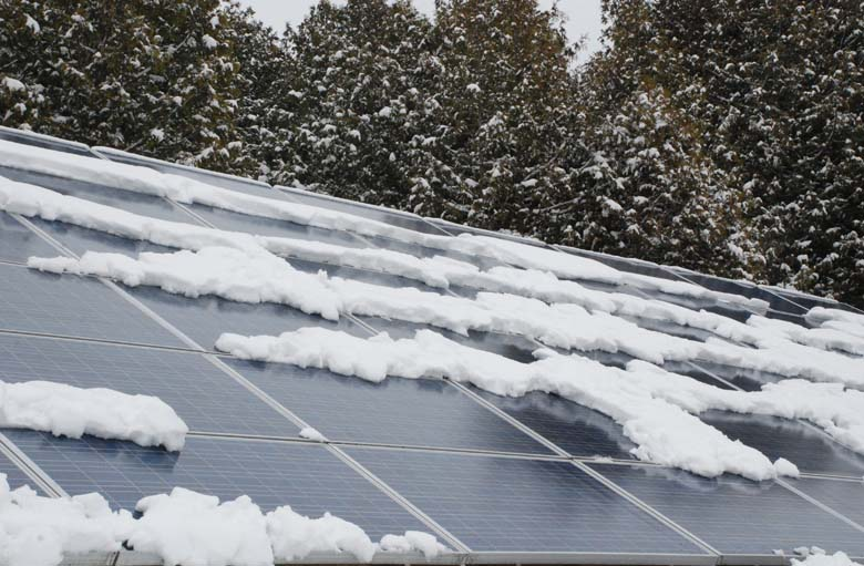 Solar panels with patches of snow melting tanken late March 2014
